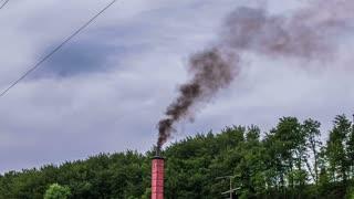 Black dangerous smoke from chimney