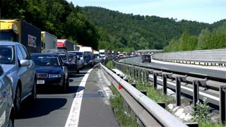 BLAGOVICA, SLOVENIA - MAY 2014: Cars And Trucks Standing Still on Highway In Midday. Traffic Jam on Highway on Slovenia highway because of accident and road redirection.