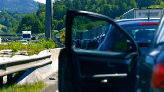 BLAGOVICA, SLOVENIA - MAY 2014: Cars Standing on AC People Having Doors Open. Traffic Jam on Highway on Slovenia highway because of accident and road redirection.
