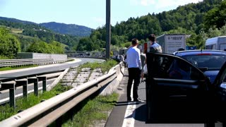 BLAGOVICA, SLOVENIA - MAY 2014: Drivers Gathering On Highway. Traffic Jam on Highway on Slovenia highway because of accident and road redirection.