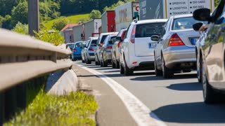 BLAGOVICA, SLOVENIA - MAY 2014: Low Angle Shot of Cars Standing Still on Highway. Traffic Jam on Highway on Slovenia highway because of accident and road redirection.