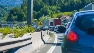BLAGOVICA, SLOVENIA - MAY 2014: Traffic Jam Moving Slowly on Highway. Traffic Jam on Highway on Slovenia highway because of accident and road redirection.