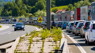 BLAGOVICA, SLOVENIA - MAY 2014: Traffic Jam on AC While Cars Passing On Other side. Traffic Jam on Highway on Slovenia highway because of accident and road redirection.