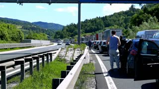 BLAGOVICA, SLOVENIA - MAY 2014: Traffic Jam on Highway People Standing Ouside. Traffic Jam on Highway on Slovenia highway because of accident and road redirection.