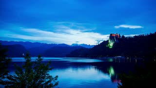 Bled Castle and church island at dawn clouds timelapse 4K