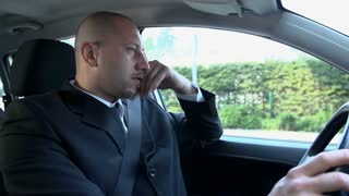 Businessman Driving Car With Depressing Look