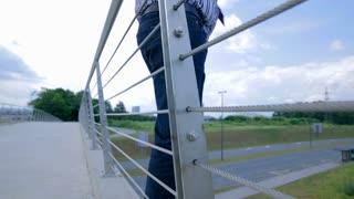 Businessman On The Edge of Bridge Doing Suicide