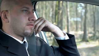 Close Up Businessman Driving Car With Depressing Look