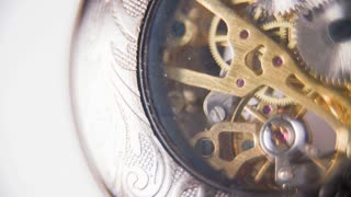 Close Up Clock Mechanism in Slow Motion. Analogue pocket watch slow motion ticking mechanism on white background macro.