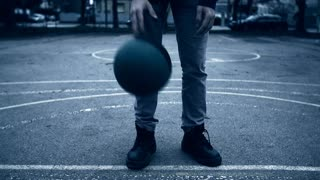 Close Up of Tapping Ball on Ground On Basketball Court
