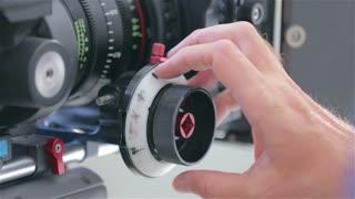 Close up on focus pull on film set