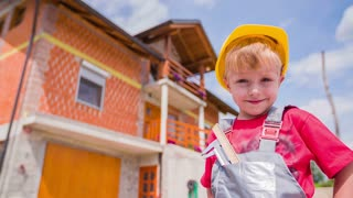 Cute Boy Portrait With Helmet and House in Background