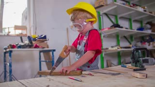 Cute Boy With Helmet Working in Workshop