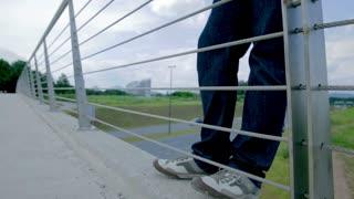 Depressed Man On Edge of Bridge