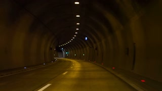 Driving through tunnel. Personal view from car while driving through dark tunnel.