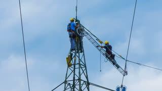 Electric engineers repairing power lines
