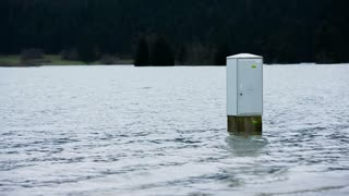 Electrical box in water. Electrical box in the middle of flooded water.