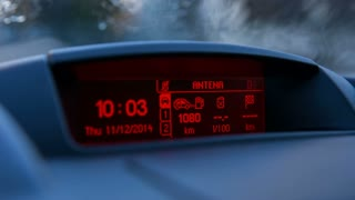 Flashing temperature on dashboard screen. Car dashboard LED screen showing clock, temperature, travel distance and other.