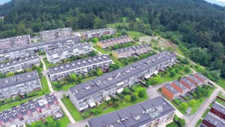 Flight over suburban settlement apartments. Aerial fly over settlement buildings placed in rows. Big neighborhood.