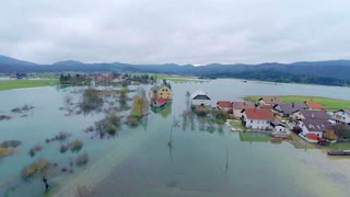 Flooded houses in village water all around. Aerial shot of whole landscape with houses under water after massive rainfall in Slovenia.