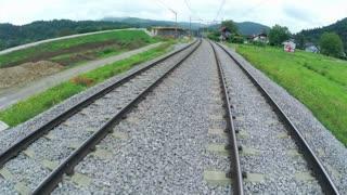 Flying on railway. Aerial flight on railway tracks.