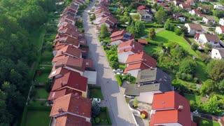 Flying over houses. Flying over suburban houses neighborhood at sunset.