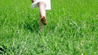 Little Girl Dancing on Green Grass Close Up Legs