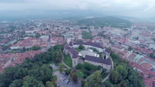 Ljubljana castle from sky on a rainy day