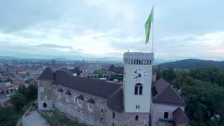 Ljubljana castle with waving flag in bad weather