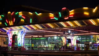 LJUBLJANA, SLOVENIA - DECEMBER 2014: Car bumping ride in amusement park. Wide shot of bumper cars amusement park ride with flashing lights around.