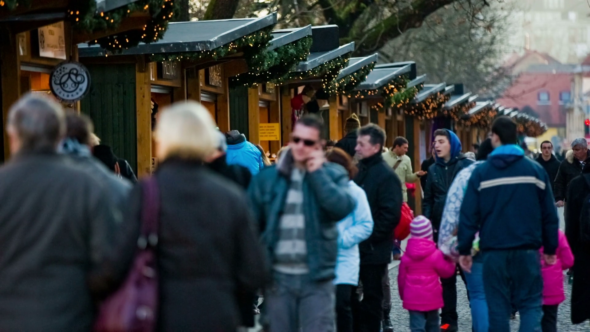Ljubljana Slovenia December 2014 People Walking Around Wooden Shooping Booths Many People Around Christmas Time Going On A Walk Through City Center And Look Through Small Booth Selling Goods Stock Video