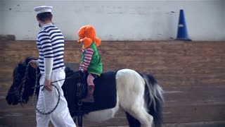 LJUBLJANA, SLOVENIA - MARCH 2014: Young Pippi Longstocking With Dad Riding Horse. Horse Riding Masquerade Competition in Big Riding Hall.