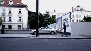 LJUBLJANA, SLOVENIA - MAY 2014: SLOW Driver Side View Of City Street. Slow motion Ljubljana city life from car side window.