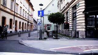 LJUBLJANA, SLOVENIA - MAY 2014: SLOW Ljubljana City Center From Car Driver Perspective. Slow motion Ljubljana city life from car side window.
