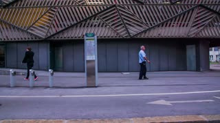 LJUBLJANA, SLOVENIA - SEPTEMBER 2014: Driving by a city bicycle stand in slow motion. Driving with car while shooting through side window a bicycle stand.