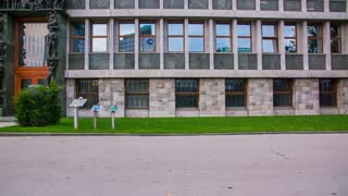 LJUBLJANA, SLOVENIA - SEPTEMBER 2014: Slovenia Parliament entrance driving by in slow motion. Slow motion shot from side window from car driving by Slovenia Parliament building.