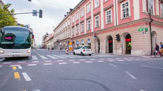 LJUBLJANA, SLOVENIA - SEPTEMBER 2014: Tourist bus driving towards the camera in slow motion. Shot from car window while turning and bus driving against.