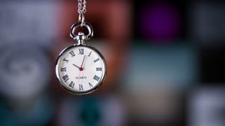 Looking at time on pocket watch. Small pocket clock in man hands close up.