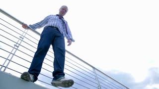 Man Standing on the Edge of Bridge Doing Suicide