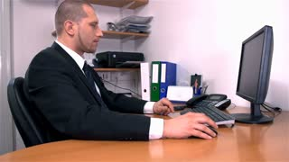 Man Working in Office Slow Motion Picking Phone