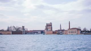 Ocean float city in Venice. Traveling on sea with view of ancient architecture on sea pillars. Sunny day with some thin clouds in sky. Famous Italy locations.