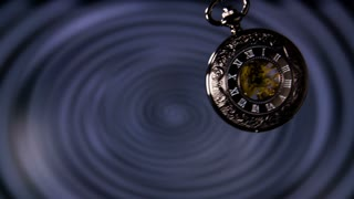Old Pocket Watch Swinging in Slow Motion. Antique pocket clock with hypnosis background.