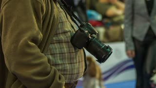 Photo camera hang on male big-belly. Male person photographer with DSLR camera hanging around neck and bouncing on big belly stomach.