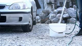 Preparing Bucket of Water For Car Wash
