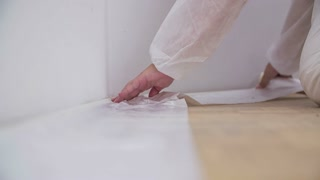 Protected floor against color dropping. Professional protection against damaging floor when painting walls with new color.