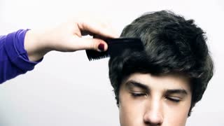 Pulling Boy Hair While Combing in Slow Motion