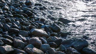 Rocks and sea waves. Close up of rocky seashore with water hitting over.