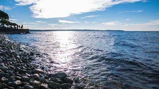 Sea and shore with sun shine. Beautiful landscape and seascape shot with sun shining on sea surface making beautiful blue scenery.
