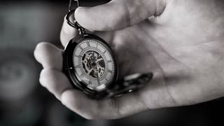 Setting Time on Pocket Watch Slow Motion Black and White. Small pocket clock in man hands close up.