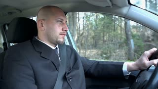 Slow Motion Businessman Driving Car And Thinking